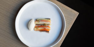 stunning fish presented in strips on blue plate at restaurant stage